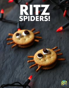 Serve up these cute spider snacks at your Halloween party! Here's what you need: RITZ Original Crackers, pretzel sticks, peanut butter, and raisin eyes stuck on with marshmallow!