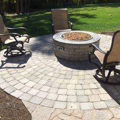 It's sweater and campfire season! Let us help build you a warm place to gather with family and friends. #Landscape #patios #Firepit #PenfieldNY