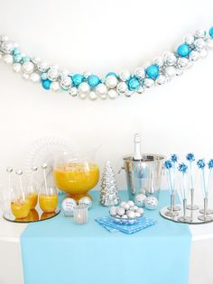 Blue & Silver Christmas Holiday Cocktail Party ideas with recipes, DIY creaive table decorations and drinks! #cocktailparty #holdayparty #partyideas #christmasparty #holidaycocktailparty #bluechristmas #silverholidayparty #blueholidaytable