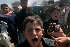 March 24, 2012. Syrians carry the coffin of 13-year-old Ahmad bin Muhsin Qarush, who was killed in a shelling by regime forces in the northwestern city of Sermin.  Ricardo Garcia Vilanova—AFP / Getty Images