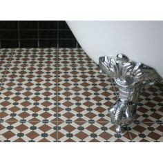 Adding a patterned floor tile can instantly lift your outdated bathroom to one of style and class.