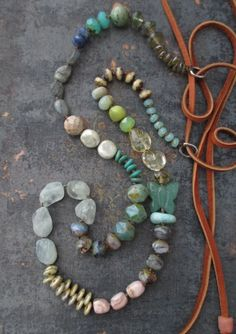 Aquamarine, labradorite, Peruvian opal, and citrine are among the many stones and glass beads in gorgeous earthy colors knotted to create this