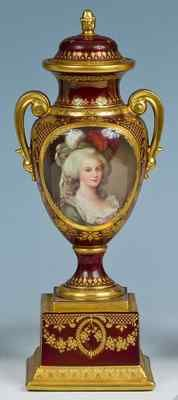 A superb antique Royal Vienna lustre porcelain vase/urn and cover, circa 1900.  Finely hand painted with Marie Antoinette portrait within gold cartouche, with raised gold gilded details all over, 32 cm high.