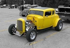 With its bright yellow paint and a black & white background, this 1932 Ford Coupe has never looked better.