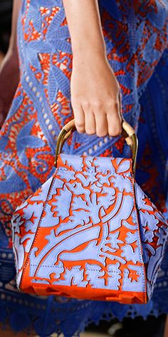 Special effects: blue suede appliqués and wicker-wrapped handles on a slouchy handbag #toryburch #toryburchss16 #nyfw