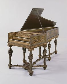 "1650 Flemish Harpsichord at the Metropolitan Museum of Art, New York - From the curators' comments: ""This harpsichord originally had only one keyboard and one set each of unison and octave strings. In the eighteenth century the case was lengthened and a second keyboard and a second set of unison strings were 
