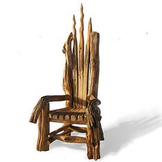 """Just an oak throne.    """"This huge throne is an exceptional piece of furniture. Uniquely handcrafted in Wales with 100% reclaimed materials it comprises some stunning pieces of driftwood collected from the west Wales coastline and reclaimed Welsh oak fence posts from local Welsh farmers."""""""