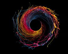 Black Hole is a series of images, which shows paint modeled by centripetal force. Black Hole è una serie di immagini create grazie alla forza centripeta. High Speed Photography, War Photography, Types Of Photography, Experimental Photography, Abstract Photography, Centripetal Force, Storm Thorgerson, Peter Saville, Fluid Dynamics