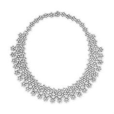 A DIAMOND NECKLACE, BY HOUSE OF TAYLOR  The front suspending an articulated fringe of circular-cut diamond florettes, to the similarly-designed backchain, mounted in 18k white gold, 15¼ ins. Signed Elizabeth for House of Taylor $122,500.00