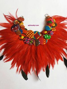 This absolutely beautiful necklace is made with carefully selected African prints buttons , beads and feathers, perfect gift for that special occasion . Get this while you can . Button Necklace, Fabric Necklace, Fabric Jewelry, Necklace Set, African Necklace, African Jewelry, Ethnic Jewelry, Feather Jewelry, Feather Necklaces