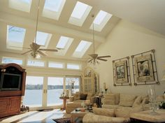 SolarGlass Window & Door offers fixed and ventilating glass skylights and roof windows in many sizes and styles. We install Velux brand skylights because of their exceptional reputation for smart design, ease of installation, and outstanding value. Options include remote-controlled motorized operators and shade systems. We also offer tubular skylights, a choice to highlight an existing room or hallway. Learn more at http://www.solarglass.com - and ask about the Velux No-Leak Warranty!