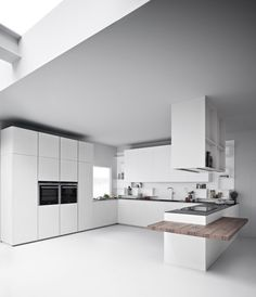 Zampieri - Line K kitchen in ice cement resin and white lacquer.