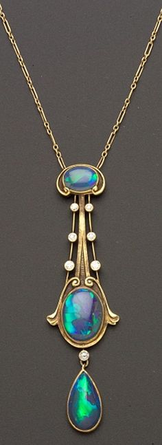 Art Nouveau Black Opal and Diamond Pendant, The Brassler Company, Newark, New Jersey, set with three opal cabochons among scroll and knife-edge motifs, seven old European-cut diamond melee highlights, completed by delicate fancy link chain, 14kt gold mount