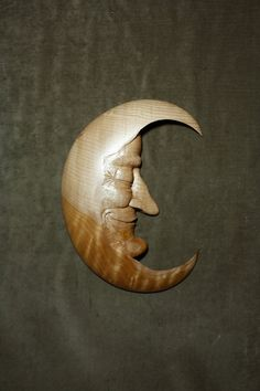 One of my favorite Moon Men in Curly Maple.