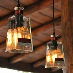 I would take off the label but cook idea. Recycled 1800 Tequila Bottle Pendant Lamp with old fashioned light bulb Tequila Bottles, Liquor Bottles, Glass Bottles, Empty Bottles, Patio Lighting, Bar Lighting, Pendant Lighting, Pendant Lamps, Lighting Ideas