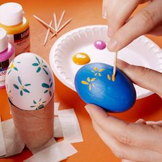Add pretty flowers to Easter eggs using a toothpick and paint! See more creative Easter egg decorating ideas: http://www.bhg.com/holidays/easter/eggs/quick-and-easy-easter-egg-decorations/?socsrc=bhgpin030513toothpickeggs=12