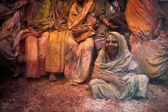 Widows daubed in colours take a break during the Holi celebrations at a temple at Vrindavan, in the northern state of Uttar Pradesh