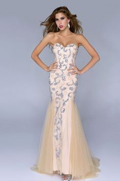 """Start out searching for your perfect long maxi strapless cream silver embroidered prom dress by flipping through magazines and online to see what kind of dress you are most attracted to. Then hit the stores with an idea in mind of what you are looking for. Try on as many dresses as you can; your idea of the """"perfect dress"""" may not be as well suited for you as another style. Don't limit yourself."""