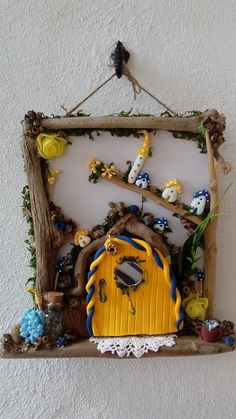 forest fairy driftwood wall hanging, with little flexible clay fairy houses, the fairy door actually opens to reveal a fairy inside, comes with a verse also, to view more pics go to jansfabfairies on facebook