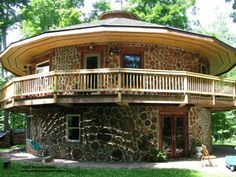 A two-story, cordwood beauty, way up north in the Upper Peninsula of Michigan. This is the home of Tom and Marcy and is home to many gardens and healing energies. Tom is a contractor and Marcy is a hands-on healer. Nice combination of skills. www.cordwoodconstruction.org