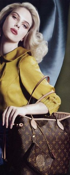 Scarlet J for LV. They have my Pochette in this shot. I must get a neverful.