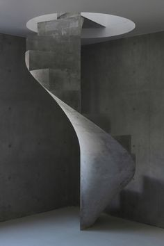 A concrete staircase spirals between the austere concrete floors of this house designed by Kazunori Fujimoto for a seaside spot in Hiroshima Concrete Staircase, Staircase Handrail, Spiral Staircase, Staircase Design, Concrete Floors, Japan Architecture, Contemporary Architecture, Architecture Details, Interior Architecture