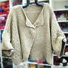 $8 WORSTED Loose-fitting, open-front, cropped kimono knit in double moss stitch and basket weave stitch. Sweater is knit back and forth on circular needles, with very little finishing required.