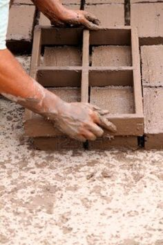 Photo about Hands of worker making bricks with clay and mud. Image of closeup, frame, craftsmanship - 14096011 Natural Building, Green Building, Brick Images, Mud House, Brick Molding, Village House Design, Off Grid Cabin, Hand Pictures, Clay Houses