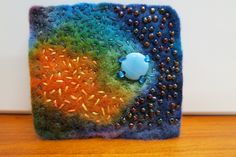 Experimenting with resists and dye on hand-made wool felt has been all-absorbing. This brooch is the end result of playing with colour and shape.  Must say I really enjoy the feeling of hand stitch…