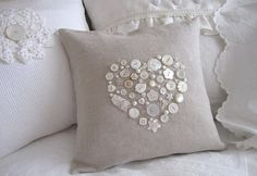 I dug through my shell shaped buttons     and made this sweet pillow.     The trick is to trace a heart    with a water soluable marker,     glue the buttons in place,     and then sew them on.