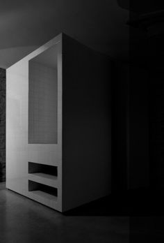 New element containing the bathroom and shower inside a converted stable by Francesco Di Gregorio and Karin Matz.