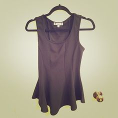 Black Peplum Top This BLACK Peplum Sleeveless Top is so cute that you can match it with anything. Wilde Tops Blouses