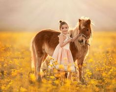 Suzy Mead Captures The Wonderful Bond Between Animals and Her Daughter Mia