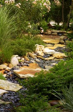 A nicely done waterless creek bed (if I have to live int he desert)