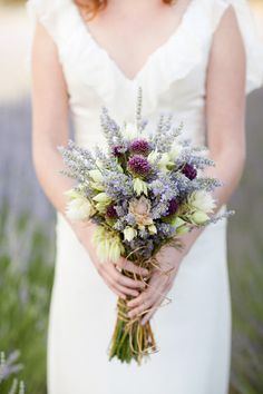 One of the most romantic bridal bouquets I have seen...it's a lavender #bouquet with bridal blush protea!  From http://rusticweddingchic.com/romantic-rustic-wedding-inspiration  Bouquet by http://bloomsbymarthaandrews.com  Photo Credit: http://ktmerry.com