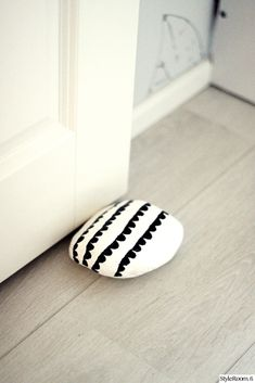 Stone door stopper--love this! Would probably add a piece of felt on the bottom so it won't scratch the floor!