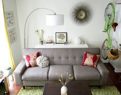 If you have a very small living room and you must put your couch against the wall, slip a console table behind it for some extra storage space.