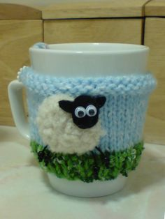 Here's my sheep mug hug. A knitted cosie, with a crocheted and felt sheep.
