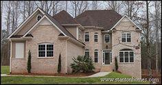 Turret style brick custom home.