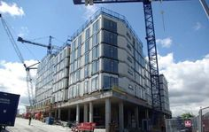 The construction of a modular multi-family building in England.: