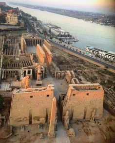 Aerial view of Luxor Temple.It's the large Ancient Egyptian temple complex located on the east bank of the Nile River in the city today known as Luxor (ancient Thebes) and was constructed approximately 1400 B. Egyptian Temple, Luxor Temple, Ancient Egyptian Art, Ancient Aliens, Ancient History, Old Egypt, Egypt Art, Paises Da Africa, Ancient Egyptian Architecture