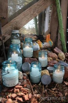 "Fill glass jars halfway with sand & add a candle. When not in use, top off with lid to keep the occasional rain from putting a damper on your night lighting when needed ("",)"