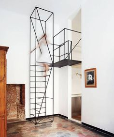 This metal staircase by Francesco Librizzi Studio is just a pure masterpiece of graphics, design and simplicity. While being practical, like jewelry, it dresses and gives style to the room.