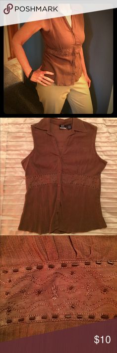 Sleeveless shirt Brown sleeveless shirt with beaded band under bust.  Bought for my daughter, but didn't fit.  Does have one small seam flaw. dcc missy Tops