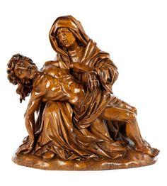 Höhe: 33 cm. Niederrhein, Mitte 16. Jahrhundert. Nussholz, ungefasst, honigbraune Alterspatina. Trauernde Mutter Maria, den toten Jesus über den Knien...