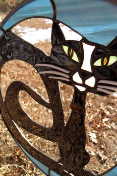 Stained glass cat Most of the background is open...no glass.