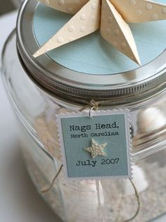 "Bring home the beach. Before leaving your beach vacation collect a little sand and a few shells. Place ""the beach"" in a jar and create a tag with the beach and date and always have a bit of the beach with you."