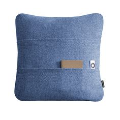 Designed by Alain Berteau  |  Objekten  The sofa cushion just got smarter. Stop looking for your remote controls or magazines. One side of the Kangaroo cushion is equipped with beautiful wallet-like sleeve pockets. Resilient and comfortable, Kangaroo cushions are available in gorgeous fabrics and colors. Covers made with high-quality wool or polyester fabrics. Cushion filled with recycled fibers and foam. Made in Europe.