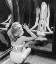 Retronaut - c. 1950s: Marilyn Monroe in a fun house mirror