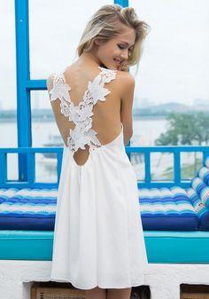 Back view of model in white crisscross back shift dress
